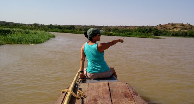 Olga in a boat on the Niger river